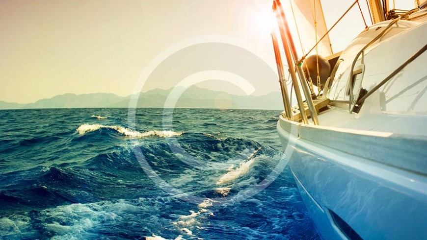 bigstock-Yacht-Sailing-against-sunset-S-23359352.jpg